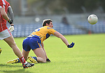 Cathal O Connor of Clare managers to get a ball away against Cork during their National Football League game at Cusack Park. Photograph by John Kelly.