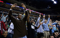 Fans cheer for the Charlotte Bobcats during an NBA basketball game Time Warner Cable Arena in Charlotte, NC.