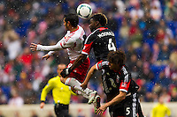 Fabian Espindola (9) of the New York Red Bulls goes up for a header with Brandon McDonald (4) of D. C. United. The New York Red Bulls and D. C. United played to a 0-0 tie during a Major League Soccer (MLS) match at Red Bull Arena in Harrison, NJ, on March 16, 2013.