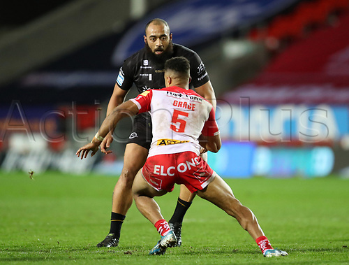 20th November 2020; Totally Wicked Stadium, Saint Helens, Merseyside, England; BetFred Super League Playoff Rugby, Saint Helens Saints v Catalan Dragons; Regan Grace of St Helens takes on Sam Kasiano of Catalan Dragons
