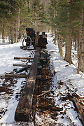 March 2012, Pemigewasset Wilderness - Remnants of a 180 foot suspension bridge that once crossed the East Branch of Pemigewasset River along the Wilderness Trail at the Trestle 17 location (East Branch & Lincoln Railroad) in Lincoln, New Hampshire USA. The bridge was removed in 2009 because of public safety issues and these remains are slowly being removed from the wilderness area. Per the Wilderness Act, only non-motorized hand tools can be used to cut these support beams. This image is from Mid March 2012.