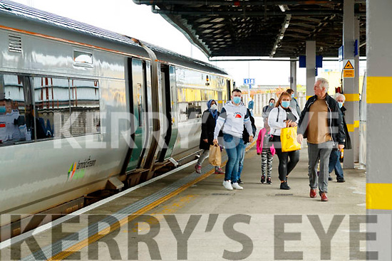 People wearing masks gettting on the train in Casement station, Tralee.