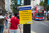 Metropolitan Police crime prevention notice in Oxford Street, London, during the 2012 Olympic Games.