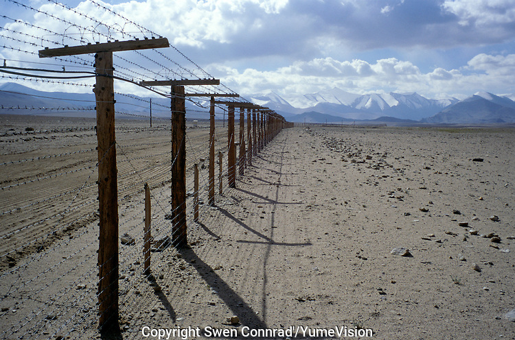 Electric barbed wire for the frontier between Tadzhikistan and China..The M41 Highway from the Ismaili capital of Khorog to the south capital of Kyrgyzstan - Osh, via the head district of Badakhshan - Murgab and the Akbajtal Pass at 4655 meters.