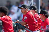Billings Mustangs hitting coach Joel Noboa (25) watches the action from the dugout during the game against the Missoula Osprey at Dehler Park on August 20, 2017 in Billings, Montana.  The Osprey defeated the Mustangs 6-4.  (Brian Westerholt/Four Seam Images)