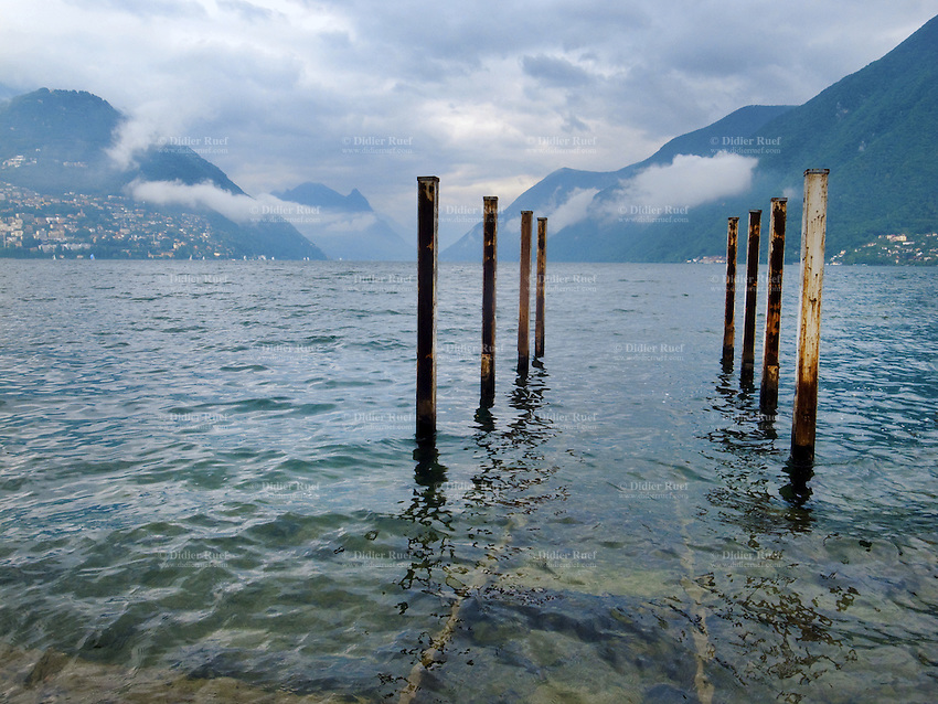 Switzerland. Canton Ticino. Lugano. View on the lake. Rusty poles. Harbour. 18.06.11 © 2011 Didier Ruef..