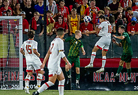 COLLEGE PARK, MD - SEPTEMBER 3: Maryland University defender Chris Rindov (18) heads down from a corner kick for Maryland's second goal during a game between George Mason University and University of Maryland at Ludwig Field on September 3, 2021 in College Park, Maryland.