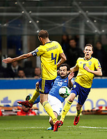 Soccer Football - 2018 World Cup Qualifications - Europe - Italy vs Sweden - San Siro, Milan, Italy - November 13, 2017 <br /> Italy' Marco Parolo (c) in action with Sweden's captain Andreas Granqvist (l) and Ludwig Augustinsson (r) during the FIFA World Cup 2018 qualification football match between Italy and Sweden at the San Siro Stadium in Milan on November 13, 2017.<br /> UPDATE IMAGES PRESS/Isabella Bonotto