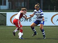 AA Gent Ladies - FC Utrecht :<br /> Pauline Windels (R) probeert de doorgang te beletten aan Sabine Beckx (L)<br /> foto VDB / BART VANDENBROUCKE
