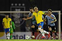 17th November 2020; Centenario Stadium, Montevideo, Uruguay; Fifa World Cup 2022 Qualifying football; Uruguay versus Brazil; Rodrigo Bentancur of Uruguay is held off by Richarlison of Brazil