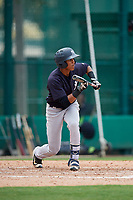 GCL Yankees West center fielder Antonio Arias (12) squares around to bunt during the second game of a doubleheader against the GCL Braves on July 30, 2018 at Champion Stadium in Kissimmee, Florida.  GCL Braves defeated GCL Yankees West 5-4.  (Mike Janes/Four Seam Images)