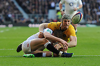 Owen Farrell of England tussles with David Pocock of Australia on the English tryline as the ball pops up during the Old Mutual Wealth Series match between England and Australia at Twickenham Stadium on Saturday 3rd December 2016 (Photo by Rob Munro)