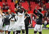 Pictured: Bafetimbi Gomis thanks supporters after the end of the game. Saturday 16 August 2014<br />