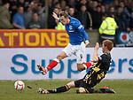 Dean Shiels avoids the tackle of Dougie Brydon