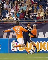 New England Revolution forward Roberto Linck (22) dribbles down the wing. The New England Revolution defeated Houston Dynamo, 1-0, at Gillette Stadium on August 14, 2010.