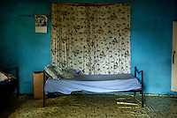 A bed in the isolation ward, where new arrivals spend their first 21 days, at the Interim Child Centre, a children's home run by the St George Foundation. Currently 21 children live in the home, all there as a result of the ongoing ebola crisis.