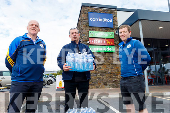 Dermot Reen and Ronan Gilsenan of Tralee Parnells receives bottled water from Aidan Sheehan (Deli Manager) of Corrib Oil on Tuesday, for their upcoming Intermediate Hurling Championship final.