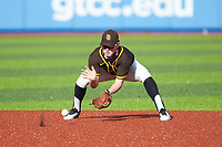 Dylan Koontz (30) of William Hough High School (NC) playing for the San Diego Padres scout team takes ground balls during infield practice prior to game three of the South Atlantic Border Battle at Truist Point on September 26, 2020 in High Pont, NC. (Brian Westerholt/Four Seam Images)