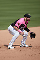 Charlotte Knights third baseman Jake Burger (9) on defense against the Gwinnett Stripers at Truist Field on May 9, 2021 in Charlotte, North Carolina. (Brian Westerholt/Four Seam Images)
