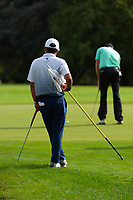 Kazuma Kobori watches Mark Brown putt. Day one of the Brian Green Property Group NZ Super 6s Manawatu at Manawatu Golf Club in Palmerston North, New Zealand on Thursday, 25 February 2021. Photo: Dave Lintott / lintottphoto.co.nz
