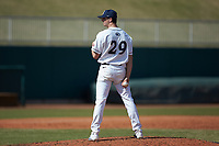 Penn State Nittany Lions relief pitcher Cole Bartels (29) looks to his catcher for the sign against the Xavier Musketeers at Coleman Field at the USA Baseball National Training Center on February 25, 2017 in Cary, North Carolina. The Musketeers defeated the Nittany Lions 10-4 in game one of a double header. (Brian Westerholt/Four Seam Images)