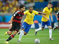 Sami Khedira of Germany takes on Fernandinho of Brazil