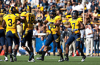 Mychal Kendricks celebrates with teammates after making the sack. The California Golden Bears defeated the UCLA Bruins 35-7 at Memorial Stadium in Berkeley, California on October 9th, 2010.