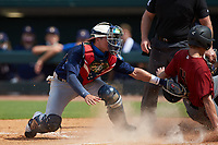 Casey Cook (4) of Freedom South Riding HS in Chantilly, VA playing for the Arizona Diamondbacks scout team slides across home plate ahead of the tag by catcher Treyton Rank (25) of Buford HS in Dacula, GA playing for the Milwaukee Brewers scout team during the East Coast Pro Showcase at the Hoover Met Complex on August 2, 2020 in Hoover, AL. (Brian Westerholt/Four Seam Images)