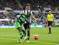 Modou Barrow of Swansea City shoots at goal during the Barclays Premier League match between Newcastle United and Swansea City played at St. James' Park, Newcastle upon Tyne, on the 16th April 2016