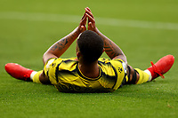 25th September 2021; Vicarge Road, Watford, Herts,  England;  Premier League football, Watford versus Newcastle; A dejected João Pedro lies on the pitch as Joshua King fails to connect with his cross late in the game