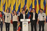 BOGOTÁ -COLOMBIA. 15-06-2014. Juan Manuel Santos (C) del partido de La Unidad Nacional acompañado de su familia y su fórmula vicepresidencial Germán Vargas LLeras (Der) durante su discurso después de ganar las eleccciones presidenciales para el período constitucional 2014-18 en Colombia a Oscar Ivan Zuluaga del partido Centro Democratico. La segunda vuelta de la elección de Presidente y vicepresidente de Colombia se cumplió hoy 15 de junio de 2014 en todo el país./ Juan Manuel Santos (C) of The National Unity party with his family and his runmate German Vargas Lleras (R) during his speech after wininning the Presidential elections for the constitutional period 2014-15 in Colombia to Oscar Ivan Zuluaga by Democratic Center party. The second round of the election of President and vice President of Colombia that took place today June 15, 2014 across the country. Photo: VizzorImage/ Gabriel Aponte / Staff
