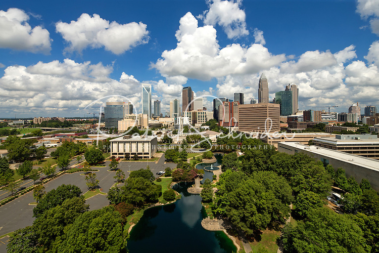 The Charlotte skyline with Marshall Park in the foreground. The park was originally constructed in 1973 as an Urban Renewal project. A 1.24 acre pond and fountain sit in the middle of the park. The park provides an open green space for citizens and lunch time patrons and is also capable of housing small to medium size events. The park is located at 800 East Third Street, the park covers 5.43 acres and is bordered by East Third Street, South McDowell Street, the Charlotte-Mecklenburg Board of Education, and First Baptist Church.<br /> <br /> Charlotte Photographer - PatrickSchneiderPhoto.com