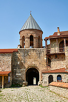 Pictures & images of the Gate house of the medieval Alaverdi St George Cathedral & monastery complex, 11th century, near Telavi, Georgia (country). <br /> <br /> At 50 meters high Alaverdi St George Cathedral was once the highest cathedral in Georgia (now its the nes Tblisi cathedral). The cathedral is part of a Georgian Orthodox monastery founded by the monk Joseph [Abba] Alaverdeli, who came from Antioch and settled in Alaverdi. On the UNESCO World Heritage Site Tentative List.
