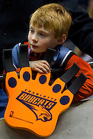 A young fan watches the action during an NBA basketball game Time Warner Cable Arena in Charlotte, NC.