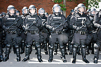 Police stand in riot gear outside the Straight Pride Parade Boston, Massachusetts, on Sat., August 31, 2019. The parade was organized in reaction to LGBTQ Pride month activities by an organization called Super Happy Fun America.