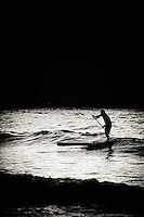 Stand-up paddleboarder coming to shore, Sayulita, Mexico.