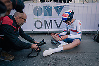 Joseph Laverick (GBR) almost collapsing<br /> <br /> post-race battlefield in the finish zone<br /> <br /> MEN JUNIOR INDIVIDUAL TIME TRIAL<br /> Hall-Wattens to Innsbruck: 27.8 km<br /> <br /> UCI 2018 Road World Championships<br /> Innsbruck - Tirol / Austria