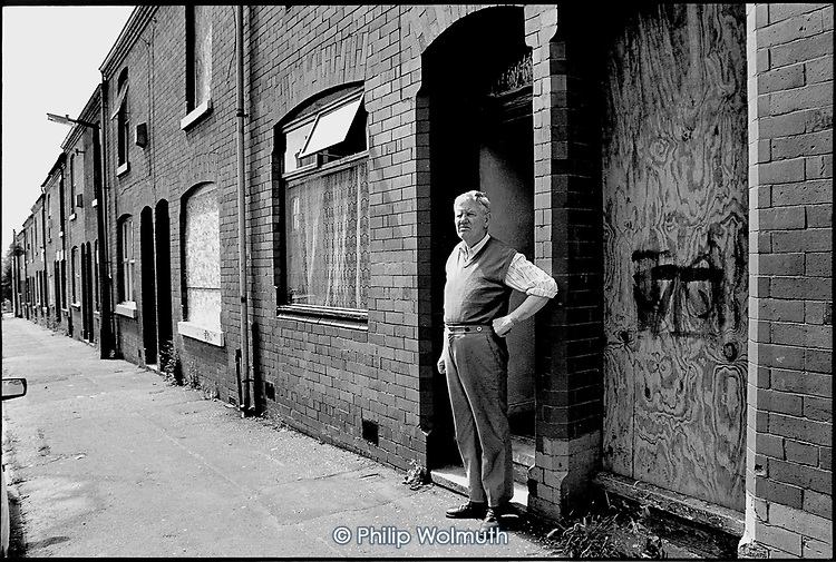 """John Collins in  May 1999: one of the last residents remaining in a street in Higher Broughton, Salford, an area suffering from """"low demand"""". The houses have since been demolished and rebuilt by a housing association."""