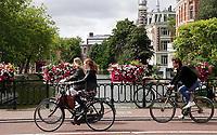 Nederland  Amsterdam - 2020.   Fietsen in Amsterdam.     Foto  ANP / Hollandse Hoogte / Berlinda van Dam