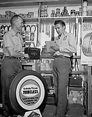 0301-341a. Richfield Oil gas station owned by Dick Hornecker (on left) in Wickenburg, Arizona, June 20, 1955