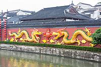 Nanjing, Jiangsu, China.  Dragons Decorate a Wall beside the Qinhuai River, Confucius Temple Area.