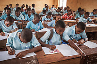 Nigeria. Enugu State. Enugu. Army Day Secondary School ( Awkunanaw in Igbo language). Classroom. Igbo students during a written exam. The pupils, boys and girls, wear blue uniforms and are 12-13 years old. They belong to the class JS2, Junior Secondary School. The Army Day Secondary School was inaugurated in October 1998. Enugu is the capital of Enugu State, located in southeastern Nigeria. 11.07.19 © 2019 Didier Ruef