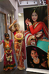 Hindu Coming of Age celebration party London Uk. The displayed photograph is of the young woman who's party it is, and her mother. She is 16yrs. Mitcham south London. She and a young relative are welcoming guests to the very big Ritusuddhi, also called as Ritu Kala Samskara. party.