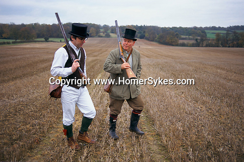 Wiltshire. 1990's <br /> At a private estate two guns wear traditional top hats at their annual black powder pheasant shoot.