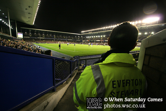 Everton 1, West Ham United 2, 14/12/2005. Goodison Park, FA Premiership. A steward watching on from the stands as Everton host West Ham United in a mid-season game on Merseyside. The away team came from behind to win, watched by a crowd of 35,704. Photo by Colin McPherson.