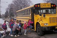 AJ3312, school bus, winter, bus, Pennsylvania, Children boarding a yellow school bus in the winter in the village of Exton in the state of Pennsylvania.