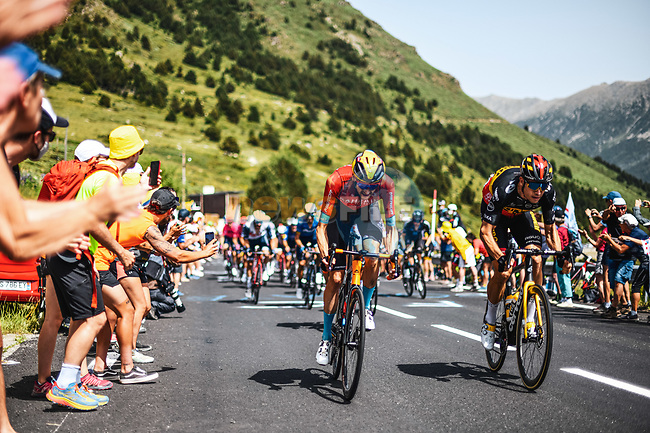 Wout Poels (NED) Bahrain Victorious and Belgian Champion Wout Van Aert (BEL) Jumbo Visma sprint for mountain points during Stage 15 of the 2021 Tour de France, running 191.3km from Ceret to Andorre-La-Vieille, France. 11th July 2021.  <br /> Picture: A.S.O./Charly Lopez   Cyclefile<br /> <br /> All photos usage must carry mandatory copyright credit (© Cyclefile   A.S.O./Charly Lopez)