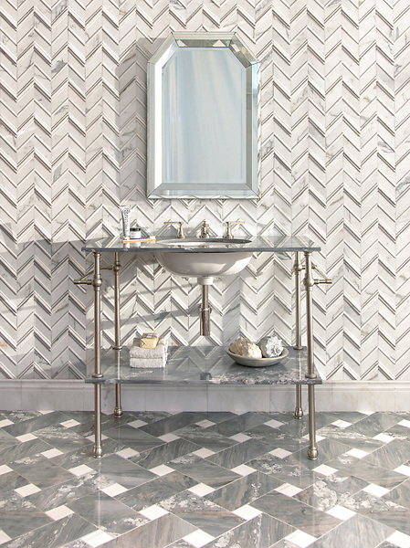 Thomas, a hand-cut stone mosaic, shown in venetian honed and honed Calacatta Tia with Basketweave Grand, a hand-cut stone mosaic, shown in polished Dolomite and Argent Blue. Thomas is part of the Tissé® collection for New Ravenna.