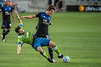 SAN JOSE, CA - OCTOBER 18: Carlos Fierro #21 of the San Jose Earthquakes battles Joao Paulo #6 of the Seattle Sounders during a game between Seattle Sounders FC and San Jose Earthquakes at Earthquakes Stadium on October 18, 2020 in San Jose, California.