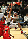 Idaho Stampede's Seth Tarver, left, and Paul Carter watch Reno Bighorns David Harrison dunk during a basketball game Sunday, April 1, 2012 in Reno, Nev. Idaho won 108-99..Photo by Cathleen Allison